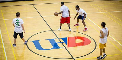 students playing basketball at UHD