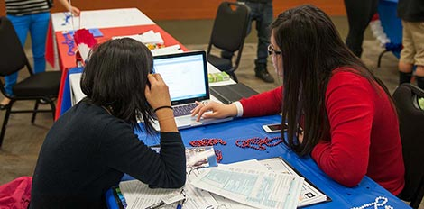 financial aid counselor helping student
