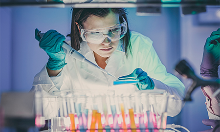 Girl working with chemicals in lab