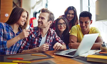 Students around talding computer