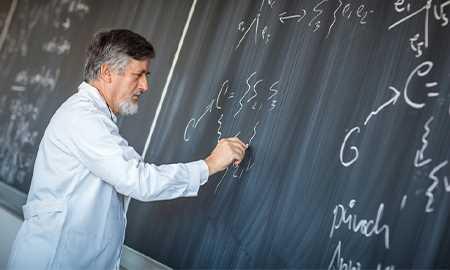 Man writing on chalk board