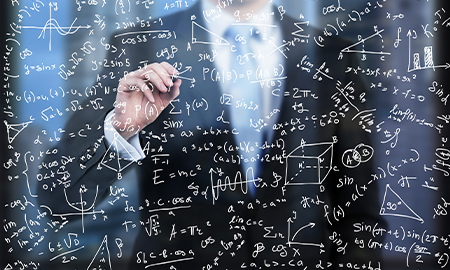 Man solving an equation