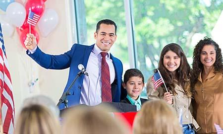 Man ad podium waving flag