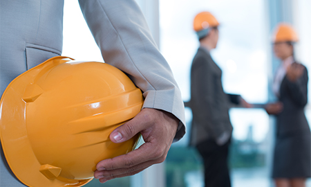 Person holding a hard hat