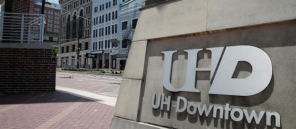 UHD signage outside the Commerce building with a view of Main street downtown