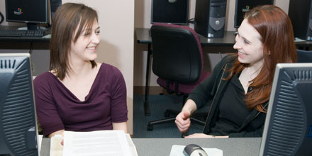 Photograph of two Professional Writing Students in class