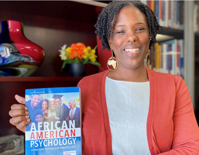Dr. Stacie DeFreitas holding her book American Psychology