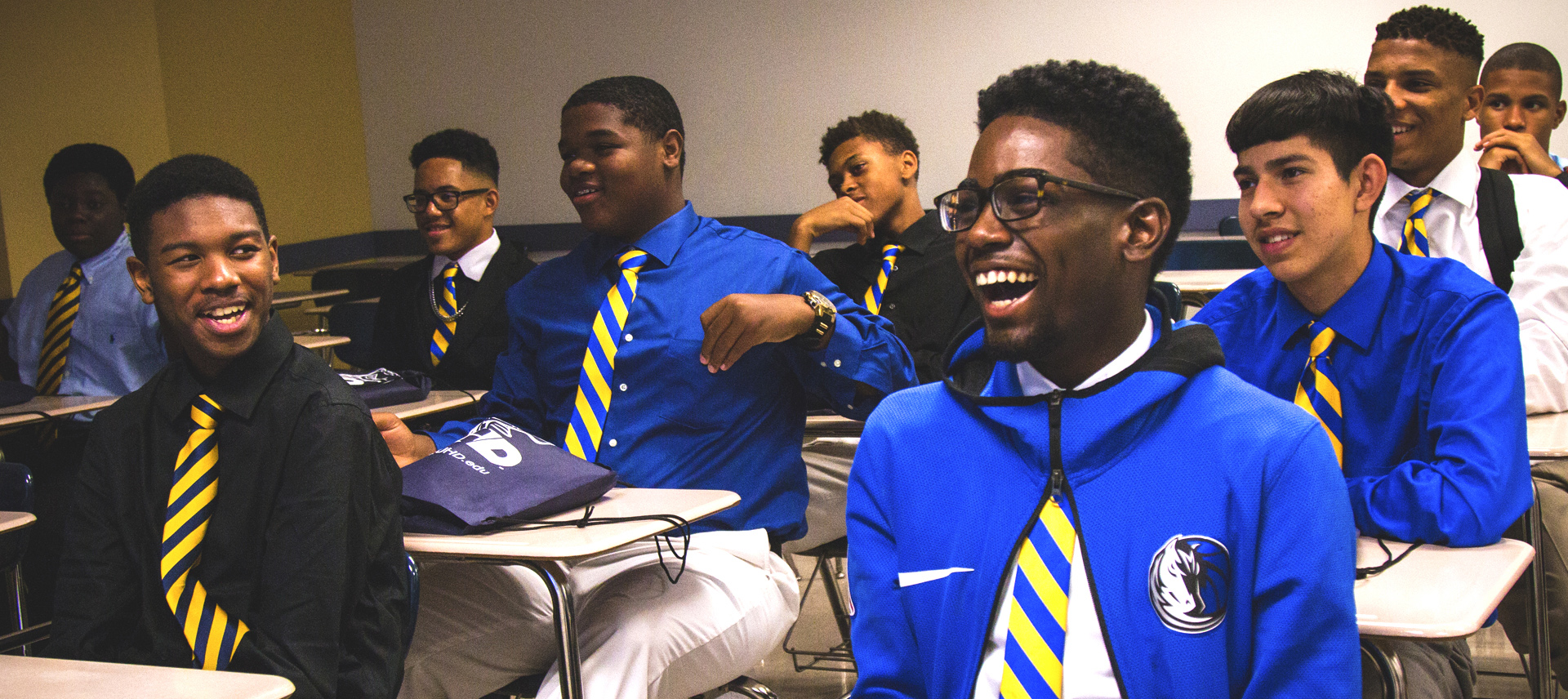 youths laughing in a class room