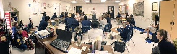 Dr. Robertson addresses students in the classroom at Westbury Christian High School
