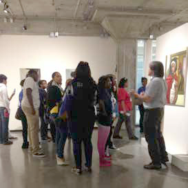 students in the OKane Gallery - Mark Cervenka speaking