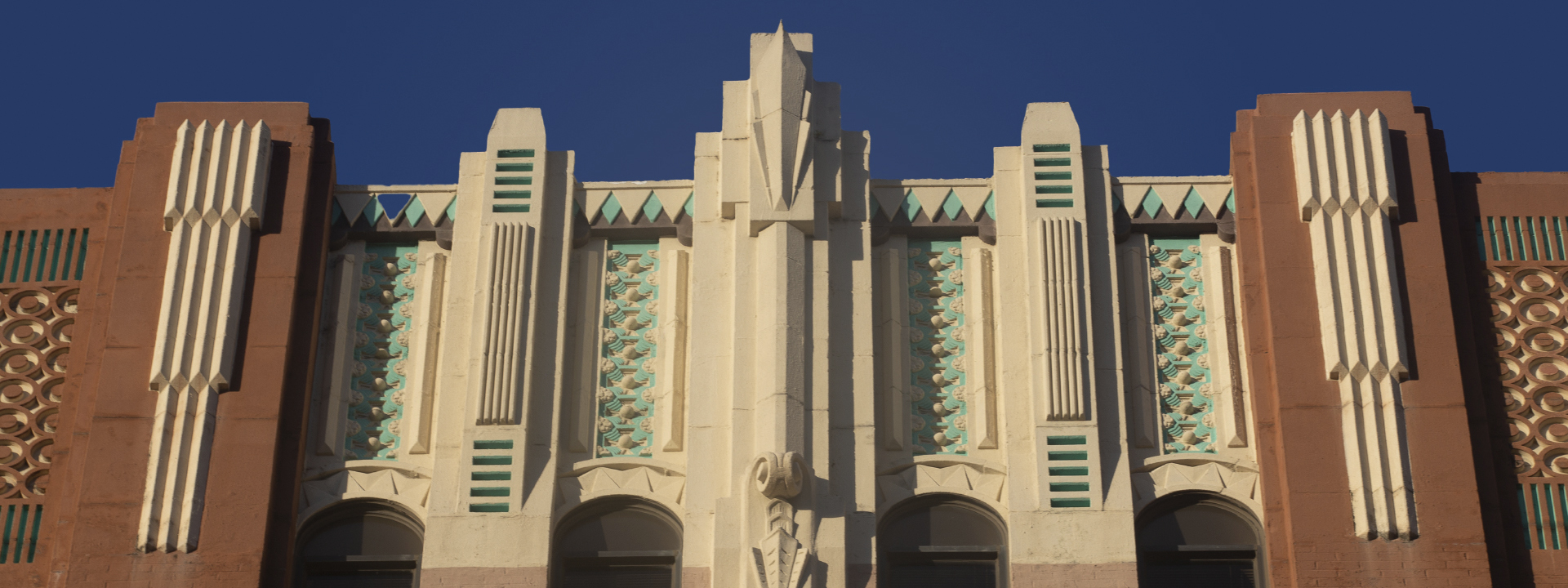 the top of the UHD main building featuring art deco elements