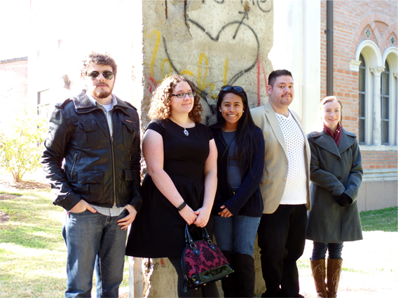 UHD's Phi Alpha Theta students at Rice University in fron of a section of the Berlin Wall