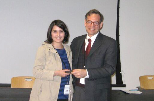 "Dr. Aaron Gillette presents Sophie Farzam with Best Conference Paper Award for her presentation on ""Challenging Gender Roles in"