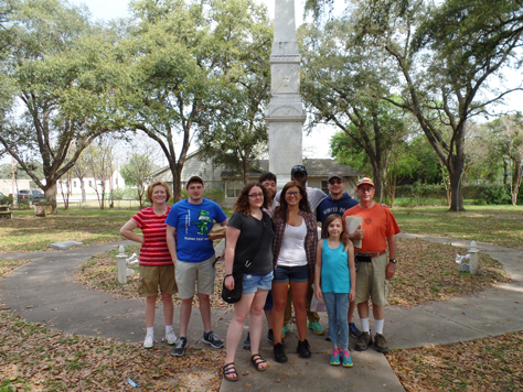 UHD Students in front of statue in Goliad