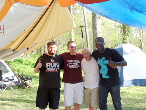 Dr. Jose Alvarez camping with members of the Webb Society and Phi Alpha Theta.