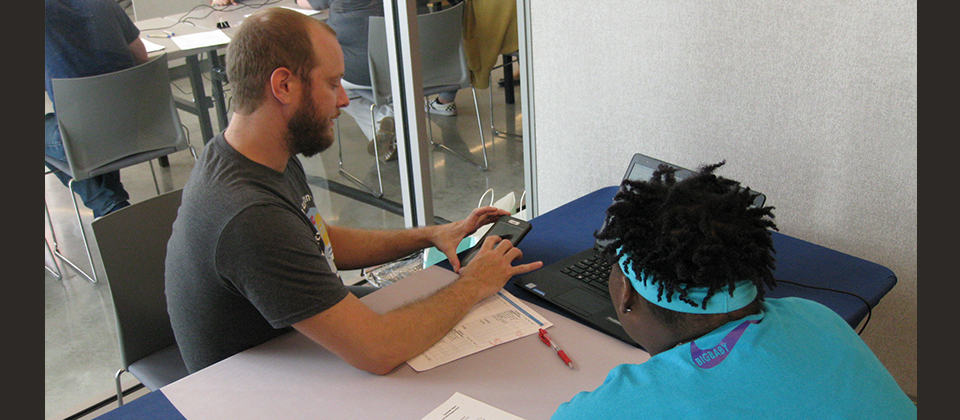 J. Burton working to register a student.