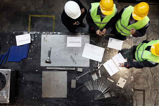 Group of construction workers looking at documents