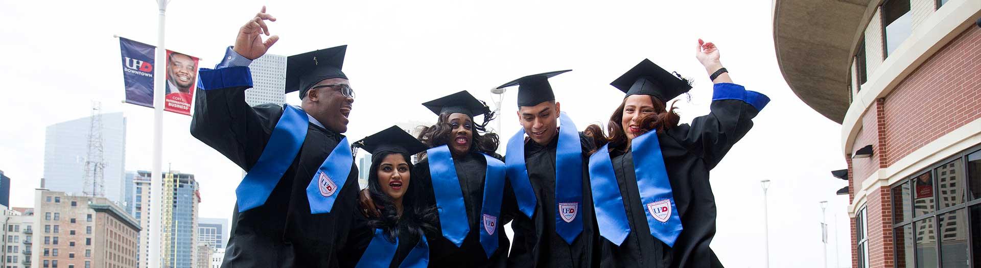 Graduates jumping up