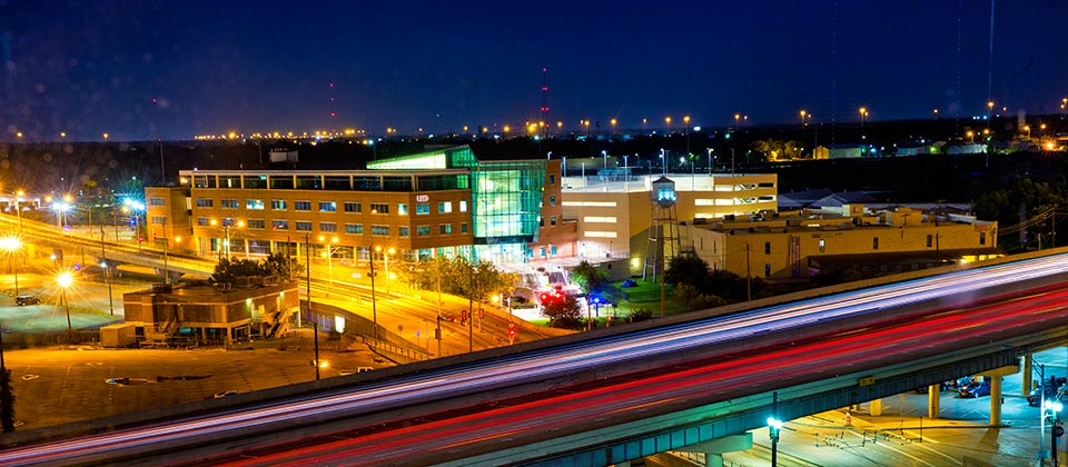 Night view of the Marilyn Davies College of Business building