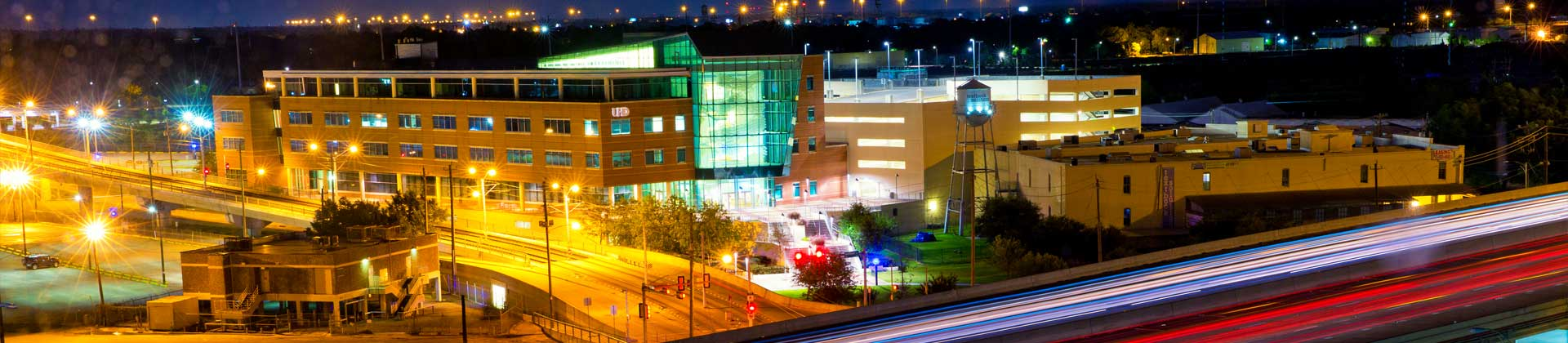 Illuminated Shea building at night