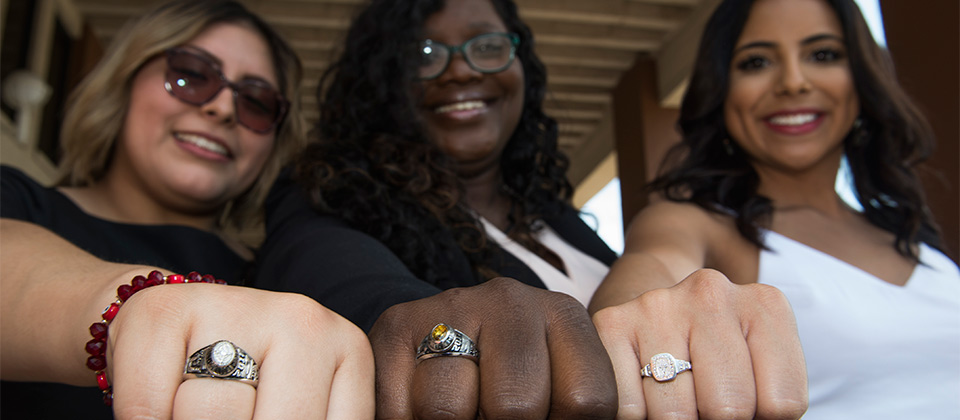 students showing off their class rings