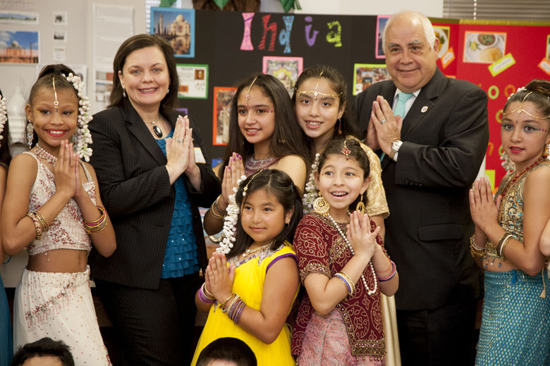 Photo of Dr. Flores and Dr. Bezette-Flores with students from Crockett Elementary