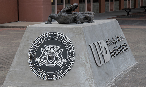 bronze gator statue outside One Main building