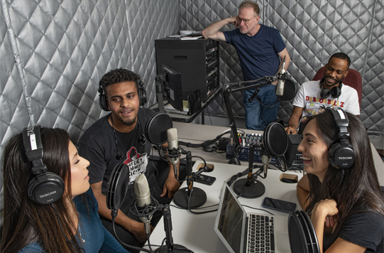 UHD students and Dr. Hank Roubicek in the iRadio studio