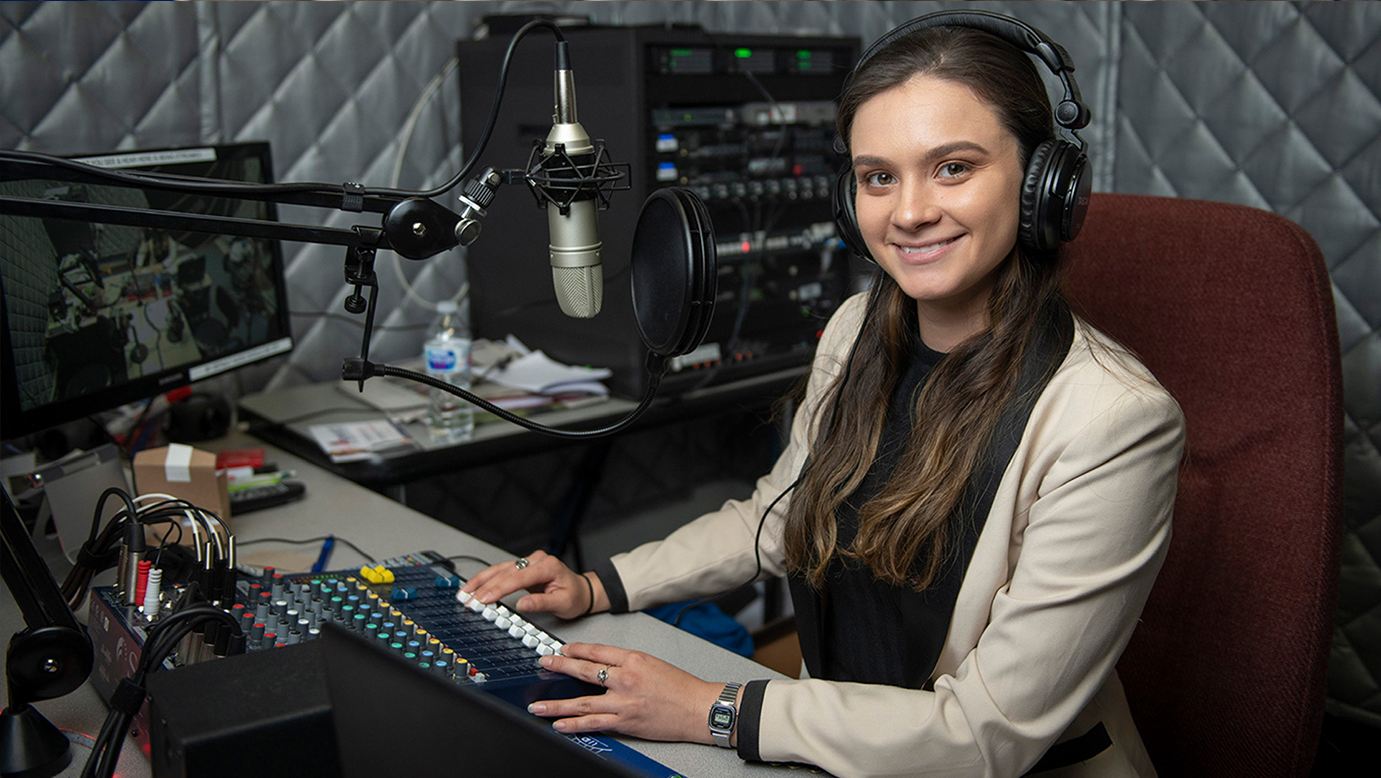 UHD student on the microphone in the UHD iRdadio studio