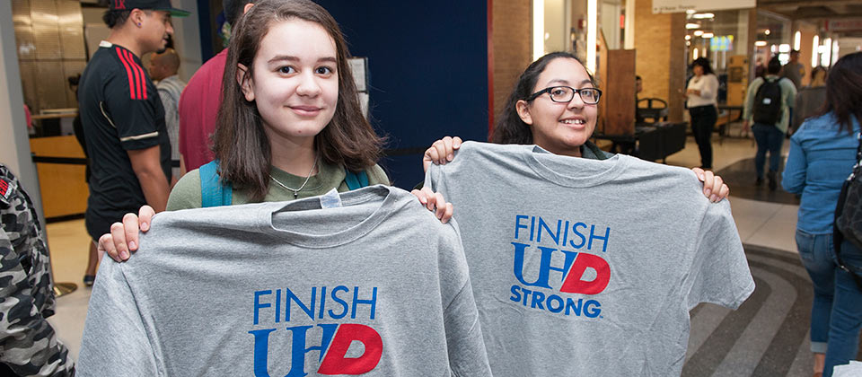students showing the UHD shirt