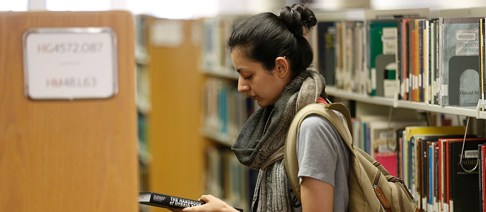 Female student in the UHD library