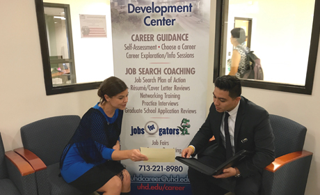Career Coach talking to student
