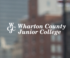 Wharton County Junior College logo with blurry buildings background.